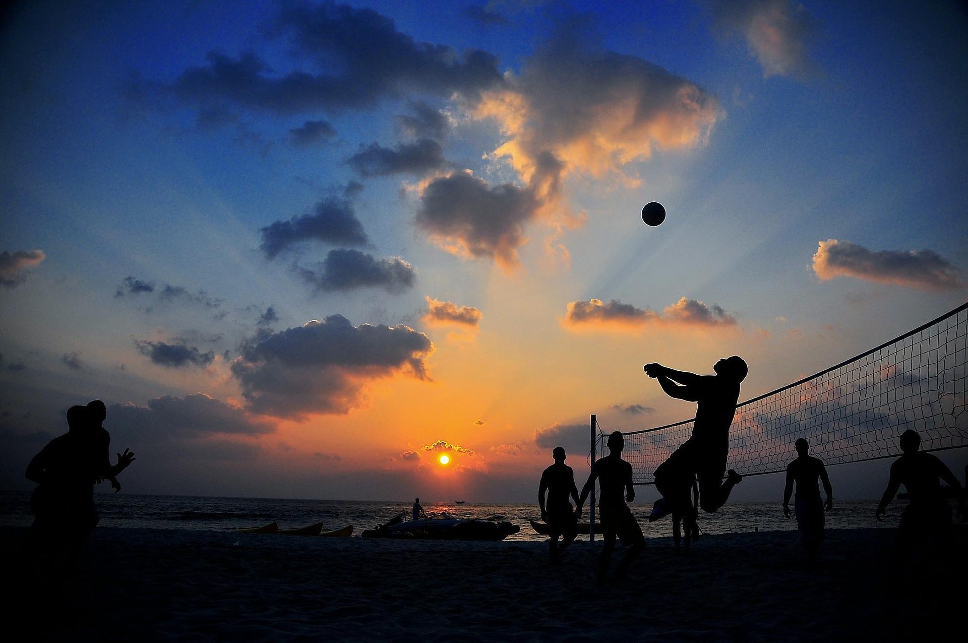 Summer beach volleyball at sunset